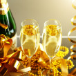 Glasses of champagne with gift box — Stock Photo