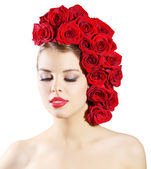 Portrait of smiling girl with red roses hairstyle isolated on wh — Stock Photo
