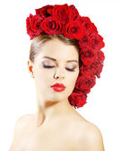 Girl with red roses hairstyle isolated on white — Stock Photo