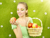 Girl with basket of apples — Stock Photo