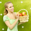 Attractive girl with a basket of apples — Stock Photo #39293107
