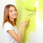 Beautiful girl painting a wall — Stock Photo #39354937
