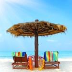 Beach chairs with umbrella — Stock Photo