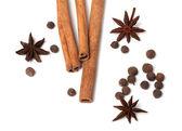 Black peppercorns, anise stars and cinnamon sticks — Stock Photo