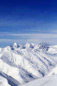 Sunny slopes of winter mountains — Stock Photo