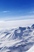 Snowy mountains in sunny day — Stock Photo