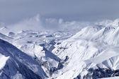 Snowy mountains in haze — Stock Photo