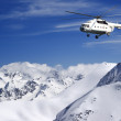 Helicopter in winter mountains — Stock Photo #14550467