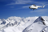 Helicopter in winter mountains — Stock Photo