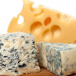 Stock Photo: Different types of cheese on old wooden kitchen board
