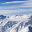 Stock Photo: Snow mountains in clouds
