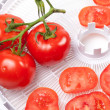 Stock Photo: Fresh tomato on food dehydrator tray