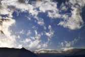 Blue sky with clouds and mountains in evening — Stock Photo