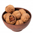 Walnuts in ceramic bowl — Stock Photo