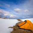 Orange tent in snow mountains — Stock Photo
