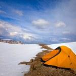 Orange tent in snow mountains — Stock Photo #26136561