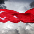 Waving flag of Turkey against storm clouds — Stock Photo
