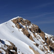 Top of mountains with snow cornice — Stock Photo