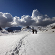 Hikers on snow plateau — Stock Photo