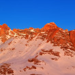 Sunrise in snow mountains — Stock Photo