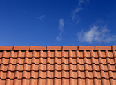 Roof tiles against blue sky — Stock Photo