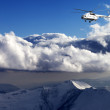 Stock Photo: Helicopter in winter mountains
