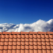 Stock Photo: Roof tiles and sunny sky with clouds