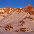 Sunrise in snowy mountains — Стоковое фото #32906515