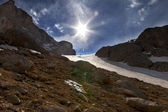 Mountain pass and blue sky with sun — Stock Photo
