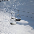 Two chair-lift with snowdrift in sun morning — Stock Photo