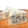 Stock Photo: Dorblu cheeses on old wooden kitchen board