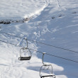 Two chair-lift with snowdrift and off-piste slope in sun morning — Stock Photo