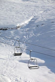Two chair-lift with snowdrift and off-piste slope in sun morning — Stockfoto