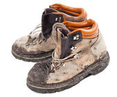 Old dirty hiking boots — Stock Photo
