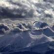 Evening mountain with clouds and silhouette of parachutist — Stock Photo