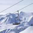 Chair lifts and off-piste slope in fog — Stock Photo