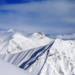 Off-piste slope and snowy mountains — Stock Photo