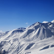 Stock Photo: View on ski slope and beautiful mountains at sunny day