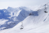 Chair lifts and off-piste slope in haze — Stockfoto