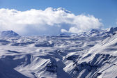 Snowy plateau and blue sky with clouds at nice evening — Stock fotografie