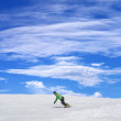 Snowboarder on ski slope and blue sky — Stock Photo #38790071