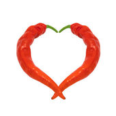 Heart composed of red chili peppers — Stock Photo