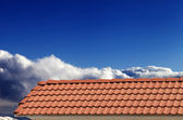 Roof tiles and blue sky in nice sunny day — Stock Photo