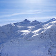 Snowy sunlight mountains, view from off piste slope — Stock Photo #39260681