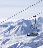 Chair lifts and off piste slope in fog — ストック写真