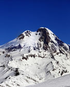 Mount Kazbek at sun winter day — Stock fotografie