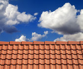Roof tiles and cloudy sky — Stock Photo