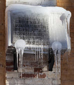 Frozen air conditioning with icicle — Stock Photo