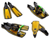 Set of yellow flippers, mask, snorkel for diving with water drop — Stock Photo