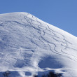 Off piste slope with trace of skis on snow — Stock Photo